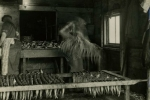 Threading herring on sticks