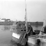 Hauling wooden lobster traps by hand