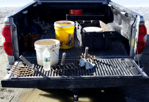 the open bed of a pickup containing tools